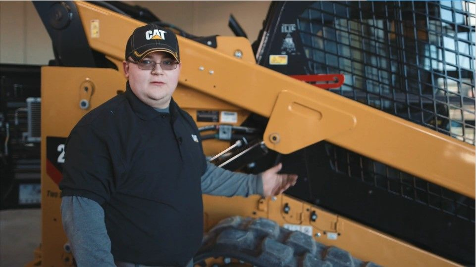 man pointing to a piece of construction equipment