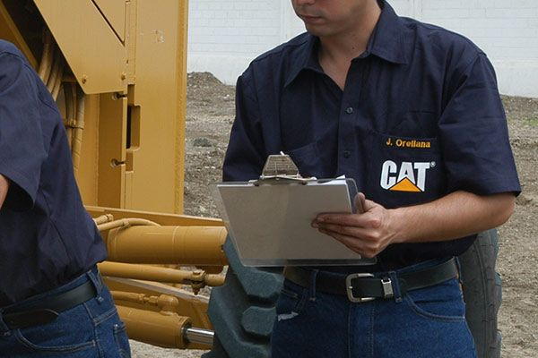 Cat employees doing an oil analysis